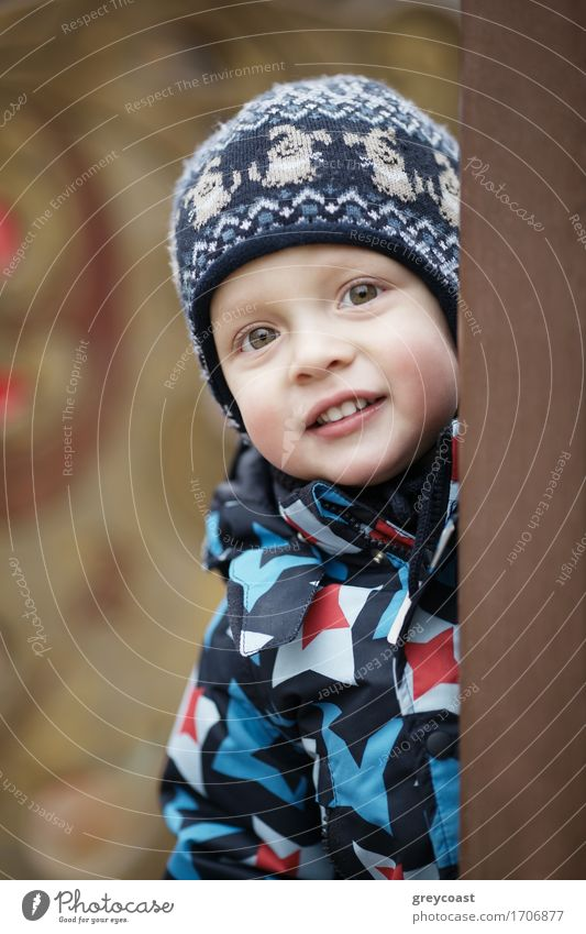 Cute little boy peering around a door Beautiful Winter Child Baby Toddler Boy (child) 1 Human being 1 - 3 years Blonde Smiling Friendliness Small Innocent cap