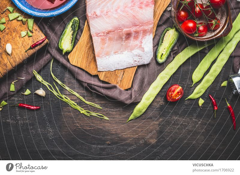 Preparation of fish fillets with green beans, tomatoes and ingredients Food Fish Vegetable Nutrition Lunch Dinner Organic produce Vegetarian diet Diet Crockery