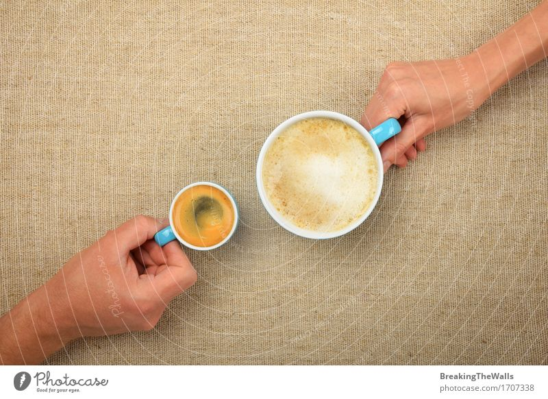 Two hands, man and woman, with coffee cups on canvas Woman Man Hand Adults Love Small Together Friendship Vantage point Uniqueness Romance Beverage Coffee Hot