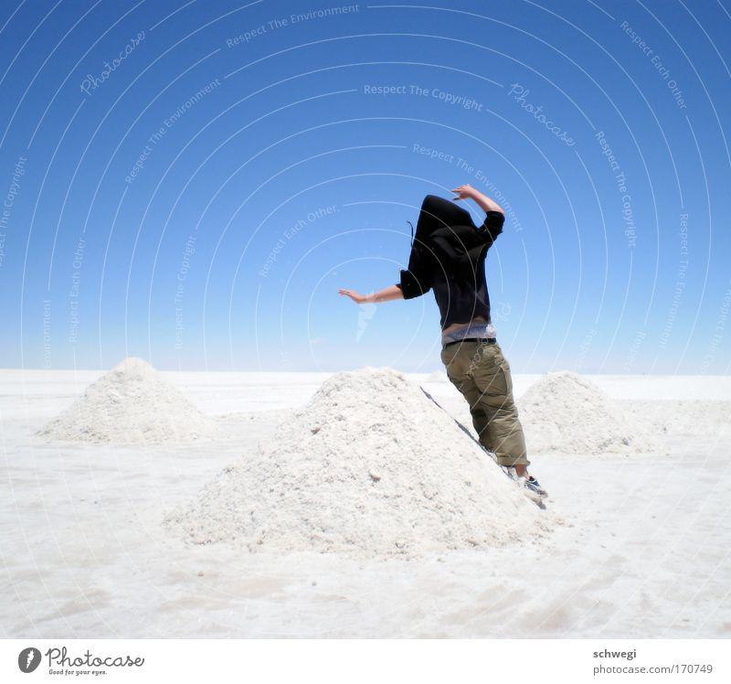 slanted salt mountains Colour photo Day Jump Hop 1 Human being Nature Landscape Sky Desert Salar de Uyuni Salt flats Exceptional Blue White Joy Cool (slang)