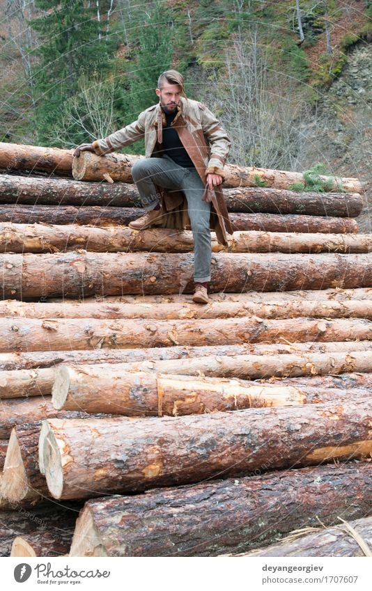 Young men on logs in the forest. Leather and jeans Lifestyle Happy Summer Human being Boy (child) Man Adults Nature Tree Forest Fashion Jeans Footwear Think