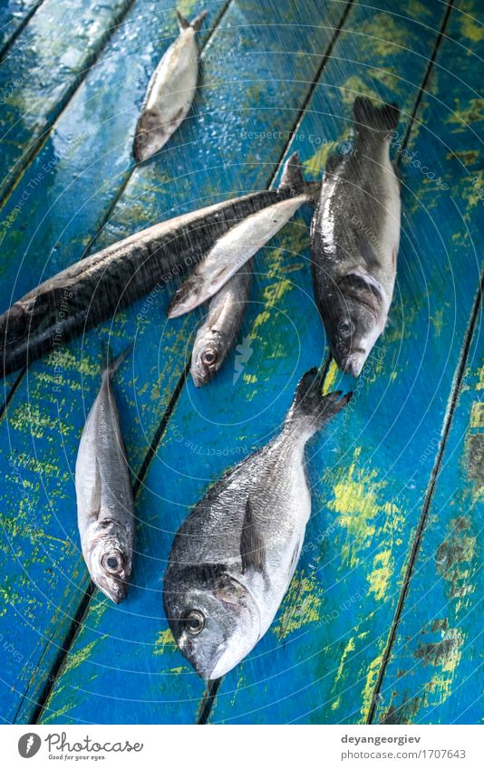 Wash fish. Sea bream, sea bass, mackerel and sardines Seafood Lunch Pan Fresh Blue Black wash watter see bass Lemon Raw cooking background healthy Frying Fat