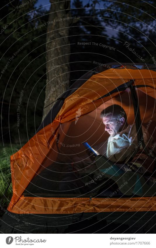 Man watching his smartphone in a tent Human being Vacation & Travel Man Summer Dark Forest Adults Lifestyle Happy Friendship Hiking Action Adventure Telephone Camping Smart