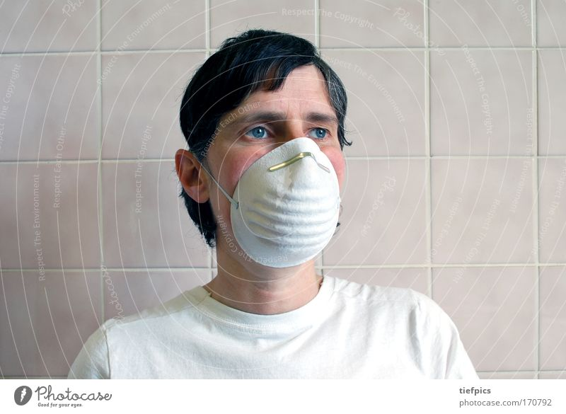 person with protective mask Interior shot Upper body Illness Doctor Androgynous 1 Human being 30 - 45 years Adults Wall (barrier) Wall (building) T-shirt