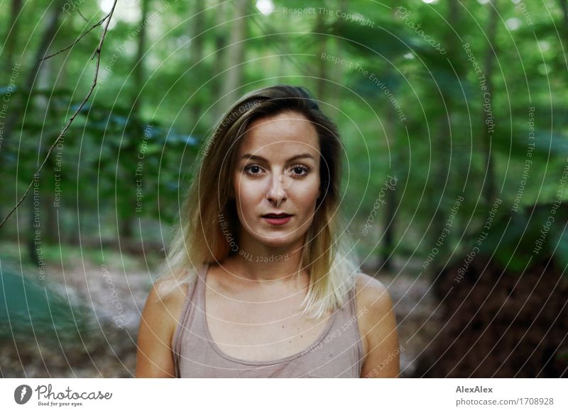 Young woman with long hair stands in the forest and looks directly into the camera Exotic Hiking Youth (Young adults) Face 18 - 30 years Adults Nature