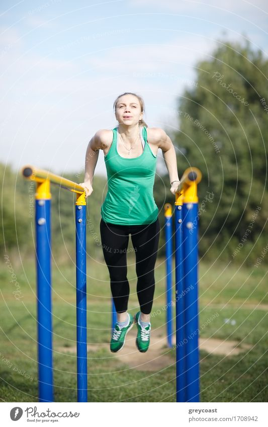 Woman gymnast exercising on parallel bars Human being Woman Youth (Young adults) Young woman 18 - 30 years Adults Sports Blonde Fitness Strong Long-haired Sports Training Vertical Musculature Practice Winter sports
