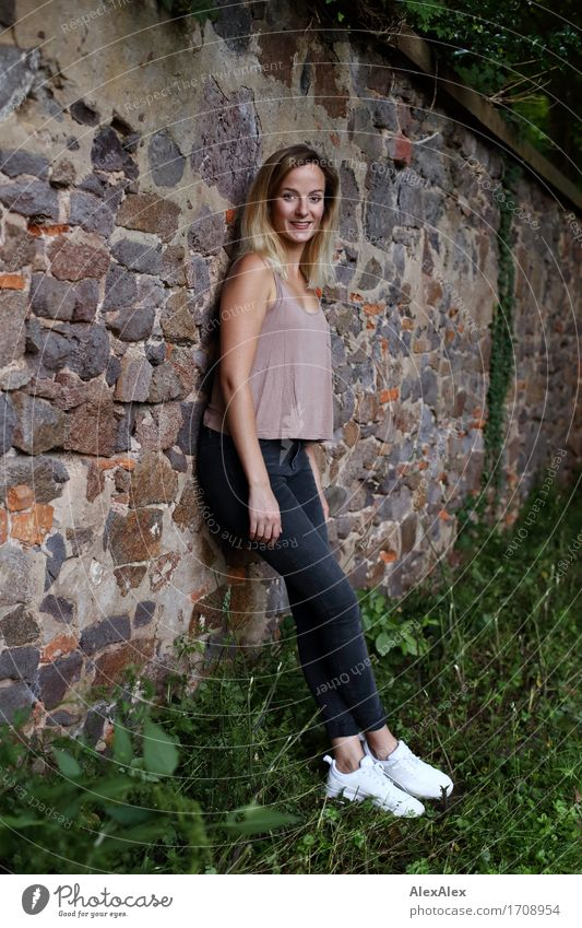 Youth (Young adults) City Beautiful Young woman Landscape 18 - 30 years Adults Wall (building) Grass Wall (barrier) Happy Stone Park Contentment Elegant Idyll