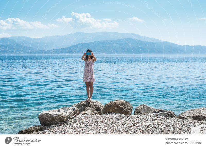 Woman taking pictures with smartphone on the beach Woman Vacation & Travel Summer Beautiful Ocean Joy Girl Beach Adults Lifestyle Happy Tourism Technology Smiling Photography Illustration