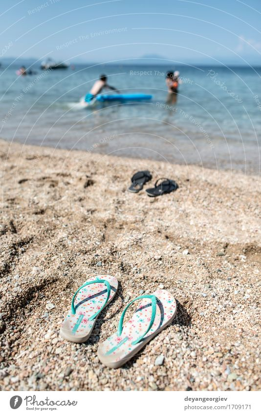 Slippers in the sand on the beach Relaxation Leisure and hobbies Vacation & Travel Tourism Summer Beach Ocean Woman Adults Nature Sand Sky Coast Footwear Blue