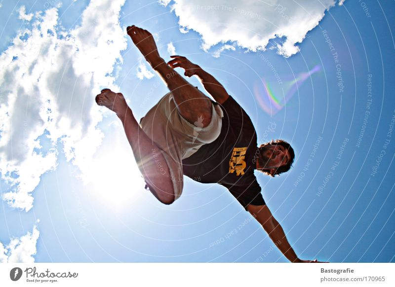 total freedom Colour photo Exterior shot Human being Masculine 1 Sports Handstand Sky Man Acrobatics Clouds Sun Summer Leisure and hobbies Barefoot Art Blue sky