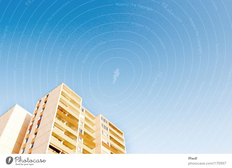 flat-sharing community Colour photo Exterior shot Copy Space right Day Worm's-eye view Flat (apartment) Cloudless sky Town High-rise Manmade structures Building