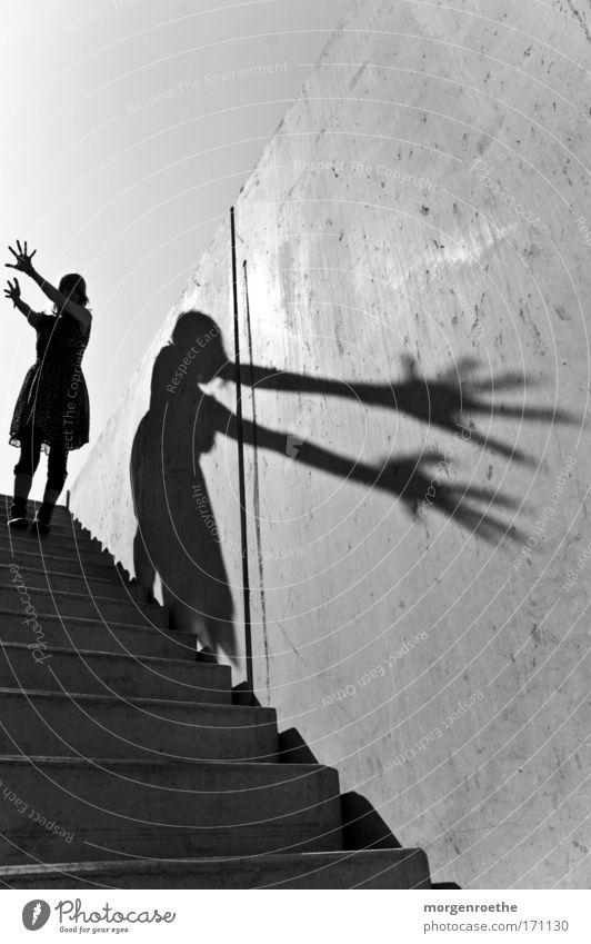 The wanderer and his shadow Hand Black & white photo Woman Dress Stairs Light Shadow Wall (building) outdoor shot Sun Warmth Playing