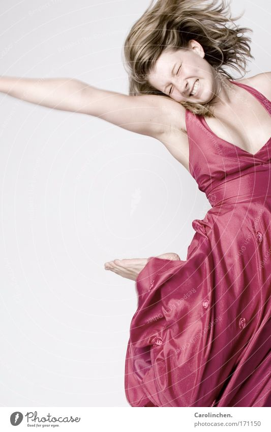joking Joy Happy Hair and hairstyles Dance Feminine 1 Human being Dress Blonde Long-haired Infinity Pink Tall Jump whirl Studio shot Copy Space left