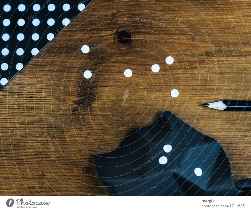 Collect points: black paper with white dots and pencil on a wooden writing table Education School Study Examinations and Tests Profession Office work Workplace