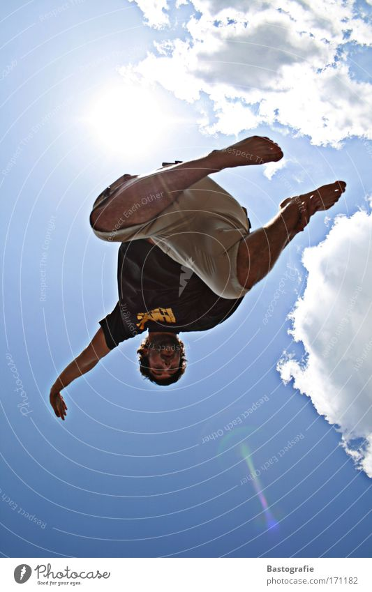 Human being Blue Sun Summer Joy Clouds Emotions Jump Weather Leisure and hobbies Flying Masculine Free Lifestyle Posture To fall