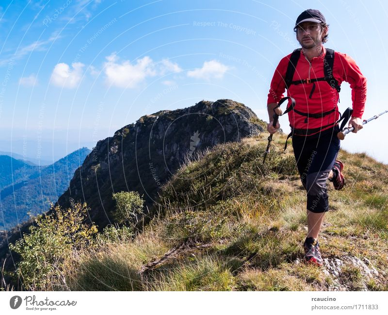 Skyrunner runs uphill along a mountain ridge Human being Nature Man Summer Sun Landscape Red Loneliness Mountain Adults Lanes & trails Sports Freedom Hiking