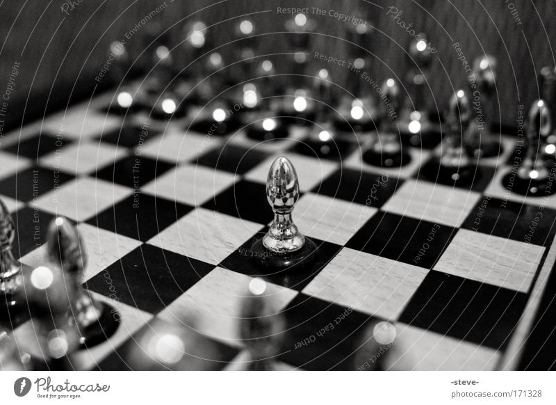 Loneliness Board game Playing Silver Silver Chessboard Chess Individual Chess piece Piece Responsibility Black & white photo Bravery
