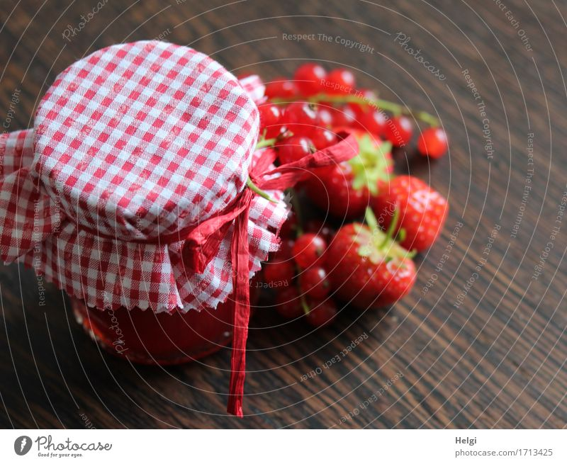 homemade food Food Fruit Jam Strawberry Redcurrant Nutrition Organic produce Vegetarian diet Glass Decoration Bow Cloth Wood Stand Esthetic Fresh Beautiful