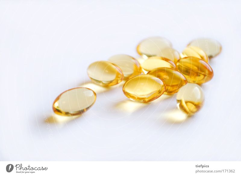 golden capsules Close-up Neutral Background Shallow depth of field Healthy Health care Science & Research Capsule Pill drug addiction Dependence Gold