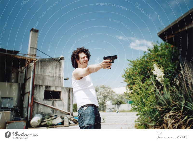 Action film - Steve Shooting Colour photo Exterior shot Copy Space top Day Contrast Sunlight Central perspective Upper body Forward Human being Masculine