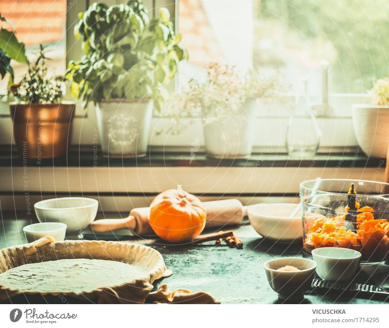 Kitchen scene with the preparation of the pumpkin cake Food Vegetable Cake Dessert Candy Nutrition Banquet Organic produce Vegetarian diet Crockery Lifestyle