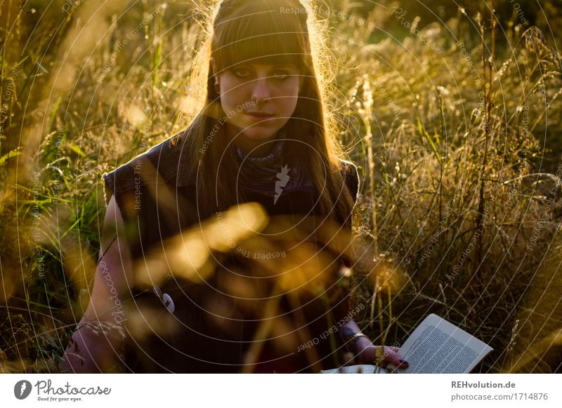 Carina reads. Human being Feminine Young woman Youth (Young adults) Woman Adults 1 18 - 30 years Environment Nature Landscape Plant Flower Grass Meadow Brunette