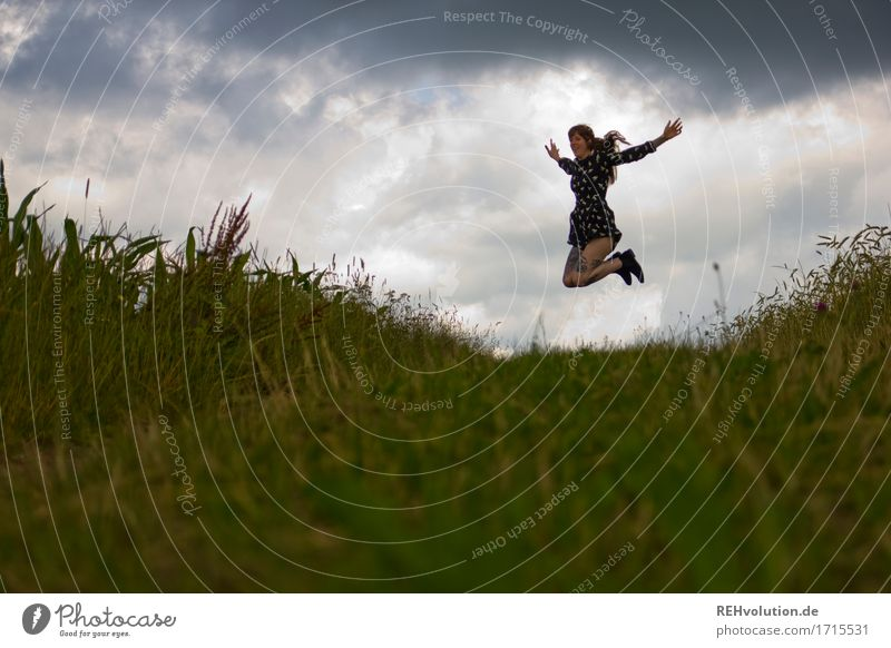 Carina jumps. Human being Feminine Young woman Youth (Young adults) 1 18 - 30 years Adults Environment Nature Landscape Sky Storm clouds Bad weather Meadow