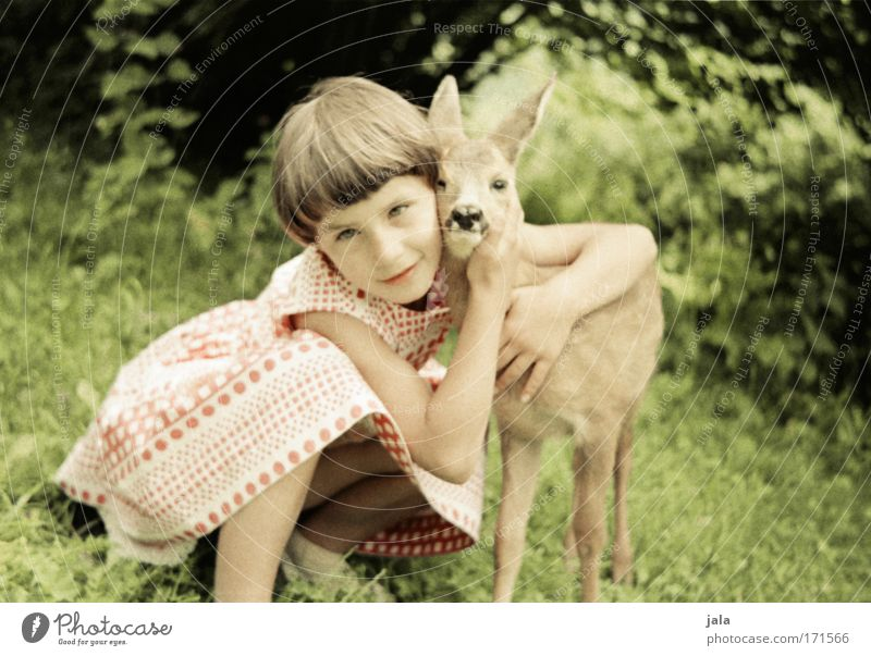 Human being Child Nature Roe deer Beautiful Girl Summer Animal Love Meadow Happy Infancy Sit Wild animal Happiness Warm-heartedness
