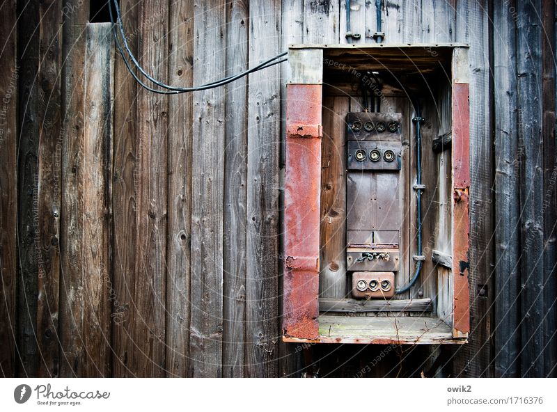 Fuses out Technology Energy industry Fuse-box Wall (barrier) Wall (building) Facade Wood Old Historic Broken Trashy Decline Transience Destruction