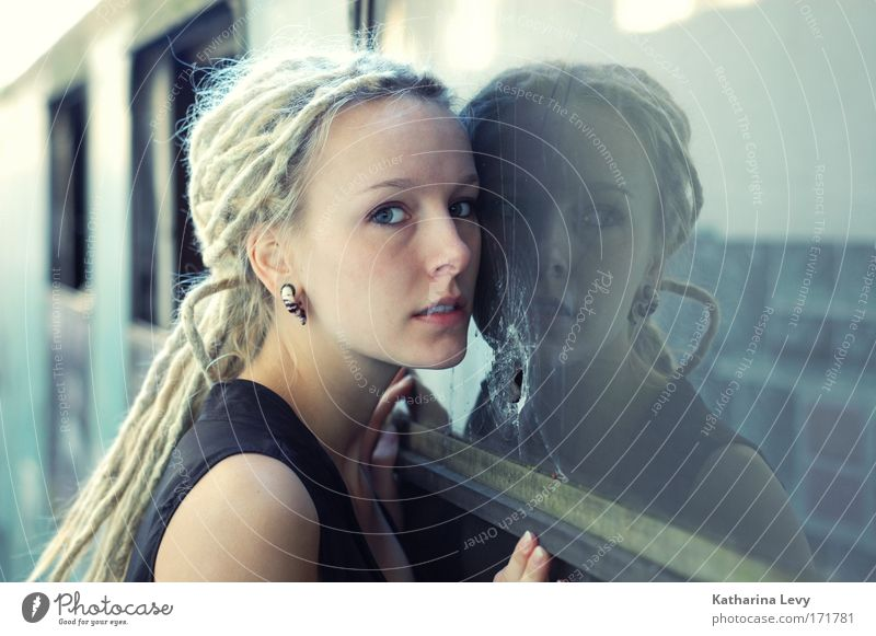 Human being Youth (Young adults) Blue Adults Window Feminine Fashion Blonde Exceptional Authentic Stand 18 - 30 years Romance Young woman Observe Curiosity