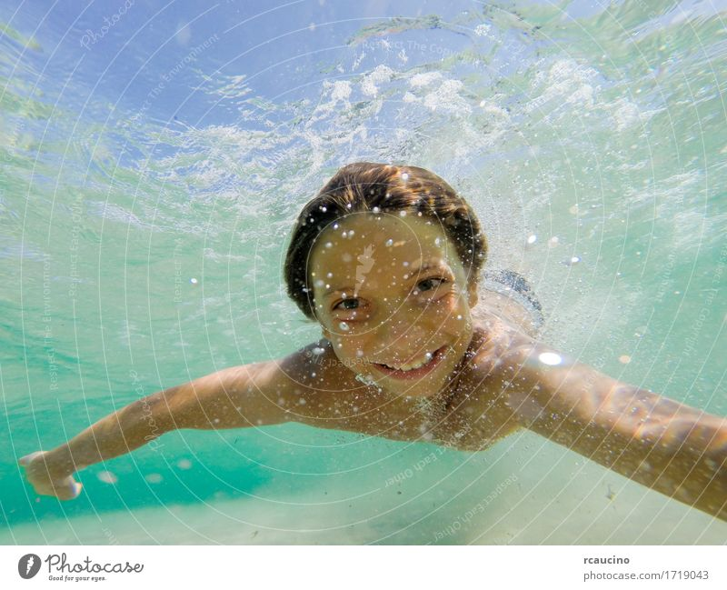Young boy swimming underwater in tropical sea Human being Child Man Blue Summer Ocean Joy Adults Sports Boy (child) Small Happy Leisure and hobbies Action Baby