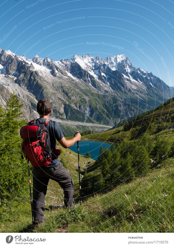 Hiker admiring mountain landscape Courmayer, Italy Human being Sky Nature Vacation & Travel Man Blue Summer Landscape Red Loneliness Mountain Adults Lanes & trails Sports Boy (child) Lake