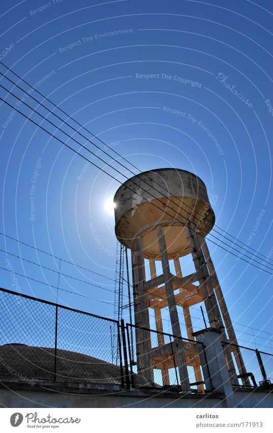 Always warm water Silhouette Back-light Wide angle Water Sky Sun Warmth Tower Architecture Old Gigantic Thirst Apocalyptic sentiment Fence Ladder Cistern