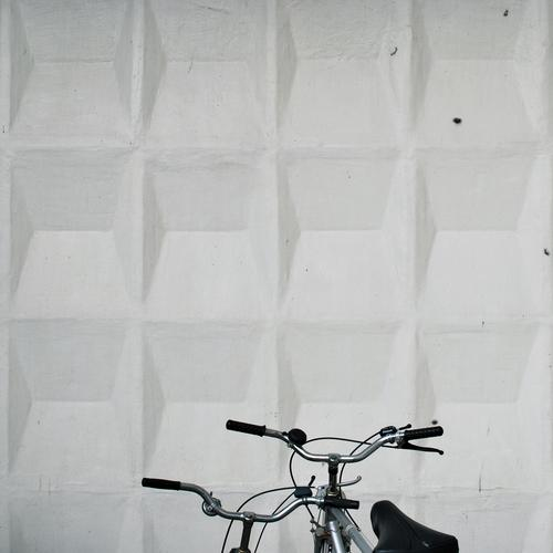 hand on heart Colour photo Exterior shot Detail Deserted Copy Space top Day Design Bicycle Architecture Wall (barrier) Wall (building) Facade Means of transport