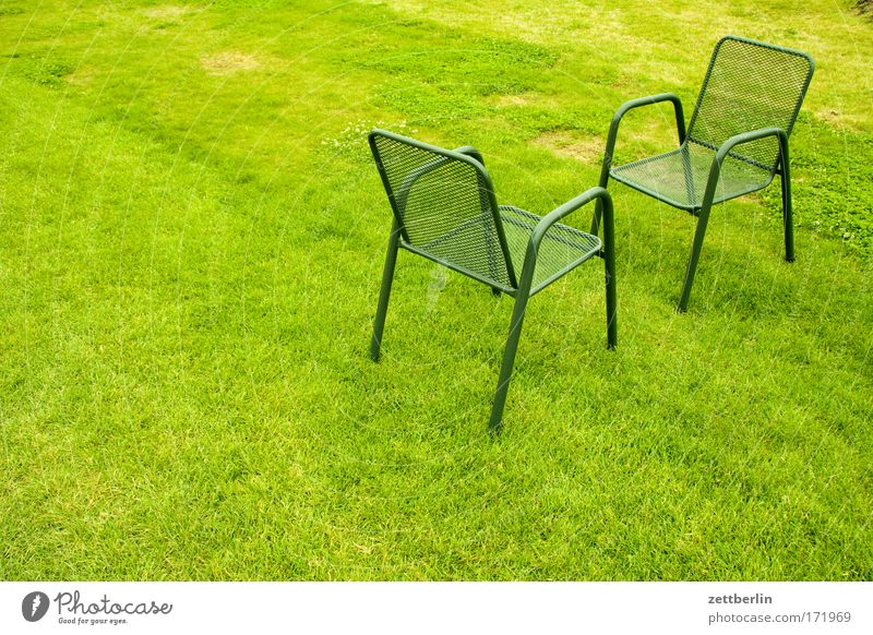 Two chairs Green Lawn Grass surface Meadow Park Chair Garden chair Outdoor furniture Meeting Date Comparison Communicate Dialog partner Opposite Places Seating