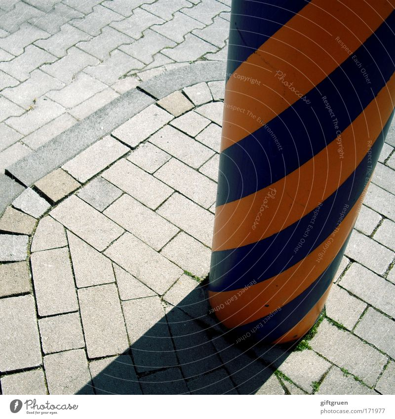striped socks Colour photo Exterior shot Pattern Deserted Light Shadow Street Lanes & trails Stone Blue Gray Column Concrete Paving stone Cobbled pathway