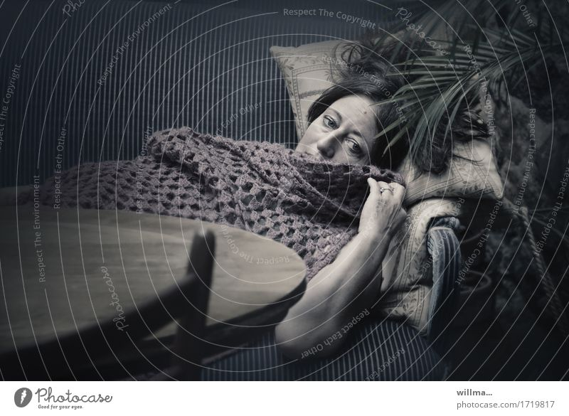 woman lies melancholically on sofa, covered with crocheted blanket Woman Adults Relaxation Lie Dark Fatigue Sofa Palm frond Sadness Dream Lady crochet cover