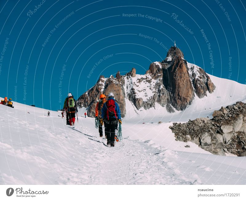 The Aiguille du Midi and a group of mountaineers. France Vacation & Travel Tourism Adventure Expedition Winter Snow Mountain Hiking Sports Climbing