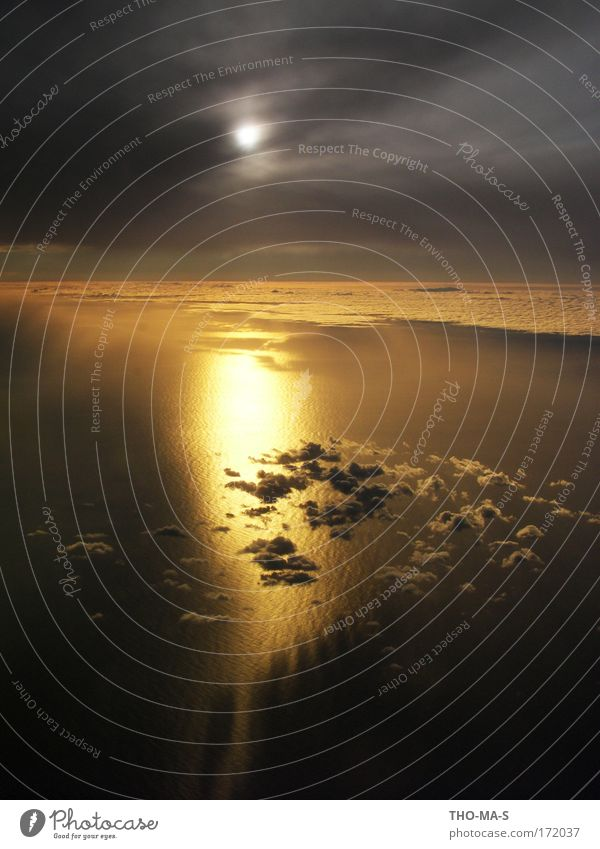 Sky Nature Water Vacation & Travel Sun Ocean Clouds Black Far-off places Yellow Environment Dark Air Dream Moody Horizon