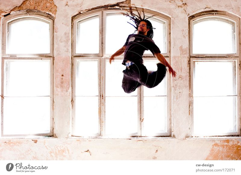 Jumping Black Colour photo Multicoloured Interior shot Copy Space left Copy Space right Copy Space bottom Day Light Central perspective Full-length Forward