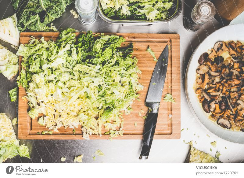 Chopped savoy cabbage with kitchen knife Food Vegetable Herbs and spices Nutrition Lunch Dinner Buffet Brunch Organic produce Vegetarian diet Diet Crockery