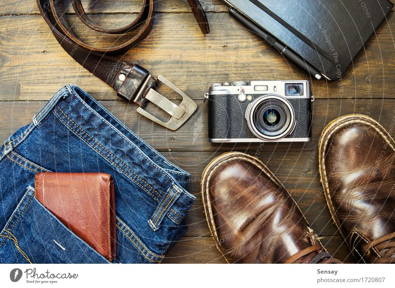 set of cool stuff on wooden backdrop Vacation & Travel Man Old Blue Adults Style Wood Fashion Brown Retro Footwear Clothing Camera Jeans Boots Leather