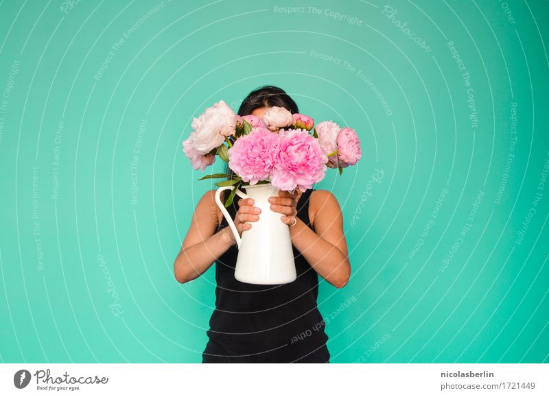 Woman holding vase with flowers in front of her face Lifestyle Style pretty Fragrance Arrange Interior design Decoration Feasts & Celebrations Valentine's Day
