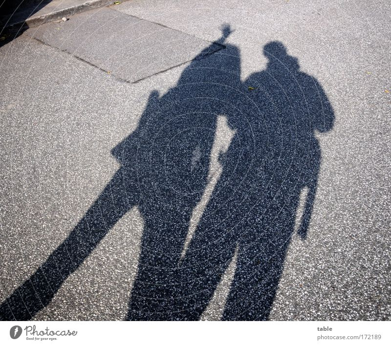 tourists Colour photo Subdued colour Shadow Full-length Lifestyle Joy Vacation & Travel Trip Human being Woman Adults Man Partner 2 Beautiful weather Pedestrian