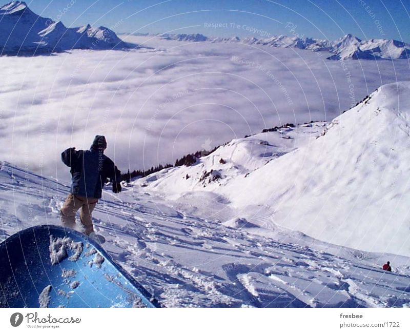 Snow Sports Together Beautiful weather Alps Snowcapped peak Tracks Downward Snowscape Valley Snowboard Cloud cover Snowboarding Snowboarder Deep snow