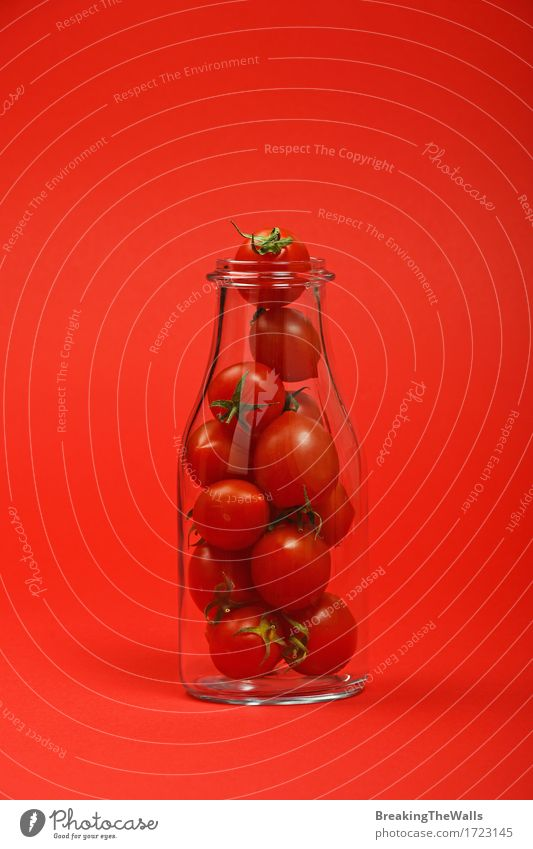 Juice, ketchup bottle full of cherry tomatoes on red Nature Colour Red Natural Small Food Fresh Idea Vegetable Organic produce Bottle Vegetarian diet Diet