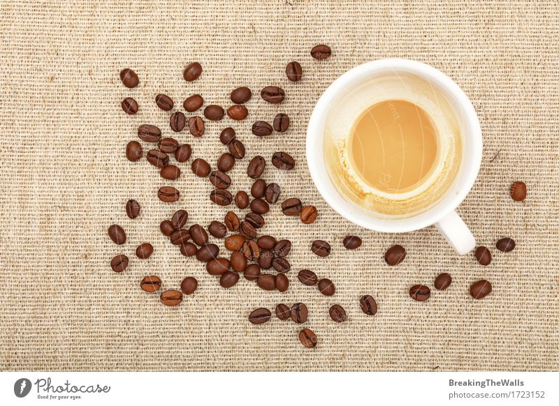 One empty finished white cup of latte and coffee beans on canvas To have a coffee Beverage Hot drink Coffee Latte macchiato Mug Cloth White Energy Relaxation