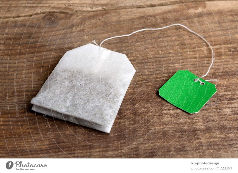 Closeup of green teabag on wooden background Beverage Tea Healthy Hot Illness Mint green say lemon get well health sniffy cold biologically organic sick disease