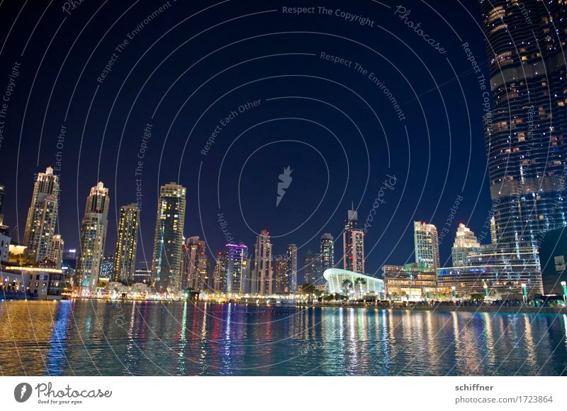 megacity Downtown Pedestrian precinct Skyline Overpopulated Multicoloured High-rise Water Lake Night life Town Crazy Loud Water reflection Burj Khalifa Dubai