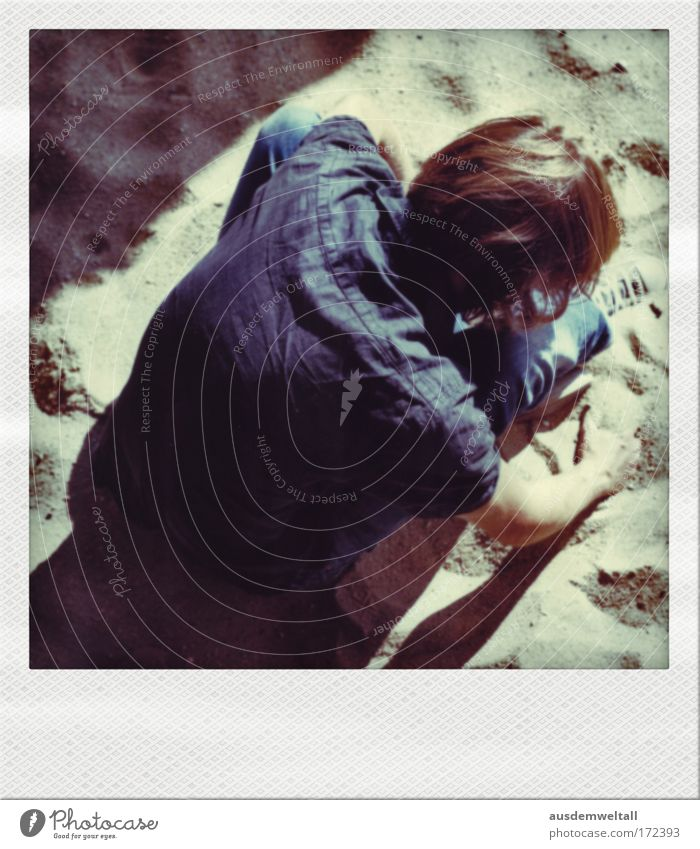 sandman Man Masculine Hair and hairstyles Long Brown Brunette Shirt Blue Jeans Sand Sit Beige Shadow Light Bright Summer Arm Hand Back Downward Polaroid